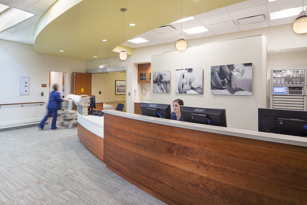 Women sitting at front desk of hospital lobby