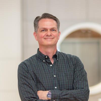 Headshot of CMBA Architect, Neil Sutton
