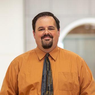 Headshot of CMBA Interior Designer, Jay Reyhons