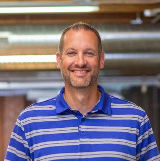 Headshot of Principal Architect, Brent Koch