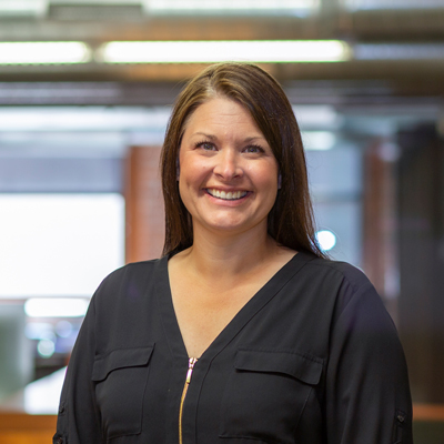 Headshot of CMBA Principal Architect, Courtney Koch