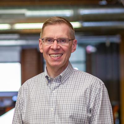 Headshot of CMBA Principal Architect, Terry Glade
