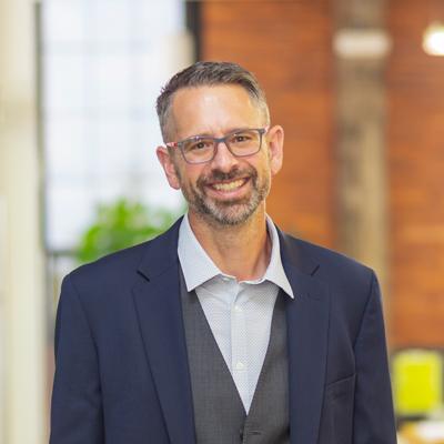 Headshot of CMBA Principal Architect Troy Keilig