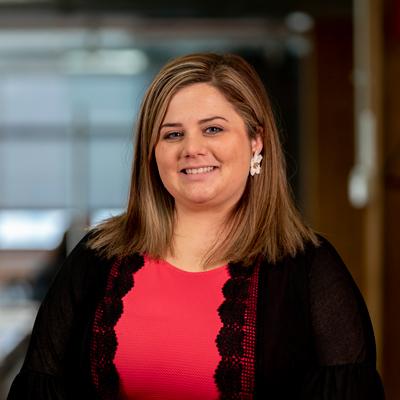 Headshot of CMBA Interior Designer, Shelbie Delaughter